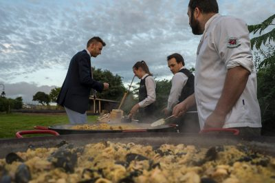 Wedding Caterers (Paella outisde a marquee) - Nova The Outsiders